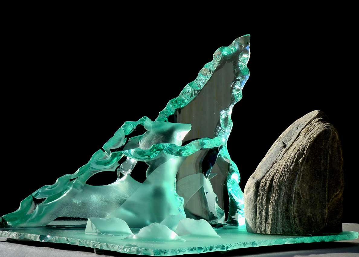 Accueil : portfolio la nature, vagues sculptées au jet de sable avec roche